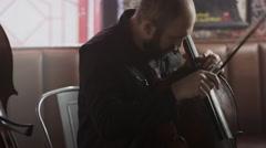Medium panning shot of strings trio playing in bar / Salt Lake City, Utah, Stock Footage