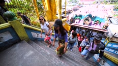 Tourists ascend a staircase in Batu Caves. View from above. Kuala Lumpur Stock Footage