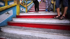 Staircase in Batu Caves and a monkey that lives here and is fed by tourists Stock Footage