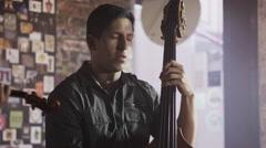 Medium panning shot of strings band playing in bar / Salt Lake City, Utah, Stock Footage