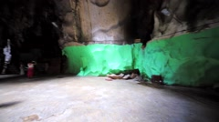Panoramic view of interior of Batu Cave with tourists in it. Kuala Lumpur Stock Footage