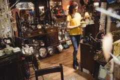 Woman looking at a vintage teapot Stock Photos