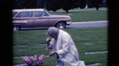 1968: pious and loving woman grieving at the grave of a loved one CLARKSDALE Stock Footage