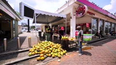 Man cuts fresh coconut for a customer to drink in the street cafe. Kuala Lumpur Stock Footage