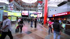 Panoramic view of interior of Kuala Lumpur Sentral railway station with tourists Stock Footage
