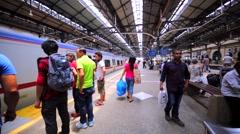 Entering the arrived train on Batu Caves station. Kuala Lumpur, Malaysia Stock Footage