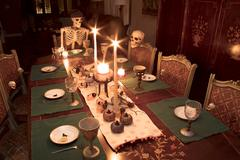 Halloween Skeleton Family Celebrating a Holiday Dinner Stock Photos