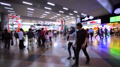 Walking in the Kuala Lumpur Sentral railway station with a lot of tourists Stock Footage