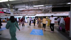 Arriving train and waiting tourists in the Kuala Lumpur Sentral Station Stock Footage