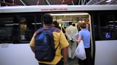 Passengers enter the train carriage at Kuala Lumpur Sentral Station Stock Footage
