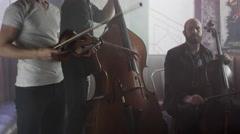 Medium shot of strings trio playing in bar / Salt Lake City, Utah, United States Stock Footage