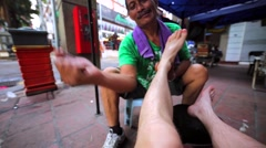 Street masseuse does massage of male legs and feetby clapping and tapping. Stock Footage