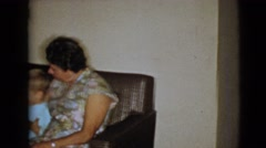 1968: grandparents sitting on couch with two young boys and dog CLARKSDALE Stock Footage