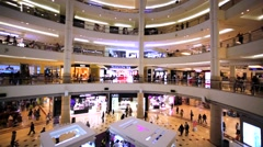 Panoramic view of interior of Suria mall with customers in Petronas Twin Towers Stock Footage