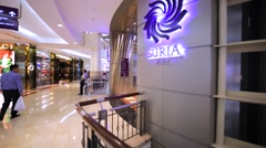 Interior of Suria shopping mall with many customers in the Petronas Twin Towers Stock Footage