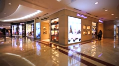 Luxury goods store of Salvatore Ferragamo store in mall Suria in Petronas Towers Stock Footage