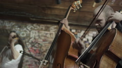Medium low angle view of strings trio playing in bar / Salt Lake City, Utah, Stock Footage