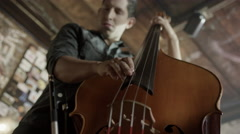 Medium low angle view of man playing double bass in bar / Salt Lake City, Utah, Stock Footage