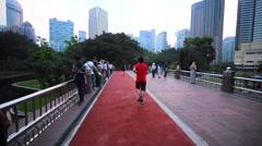 Jogging path in the park near the Petronas Twin Towers.Malaysia, Kuala Lumpur Stock Footage