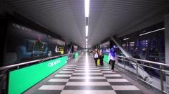 Walking along the long white corridor of the footbridge. Kuala Lumpur, Malaysia Stock Footage