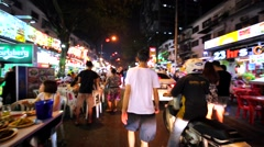 Walking along Jalan Alor street with a lot of people and many street restaurants Stock Footage