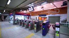 Going through turnstile in Kuala Lumpur Monorail Line, Malaysia Stock Footage