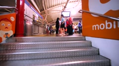 Ascending on staircase, view of platform with waiting tourists at KL Monorail Stock Footage