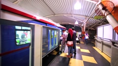 Tourists enter carriage of KL Monorail Line which contains of 11 stations Stock Footage