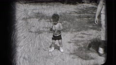1942: shirtless little toddler explores outdoors while holding a cup NEW YORK Stock Footage
