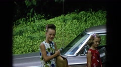 1965: girls cute dressed car road outing beautiful HAWAII Stock Footage