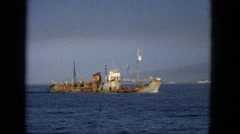 1965: a big ship on the water with a lot of bad metal HAWAII Stock Footage