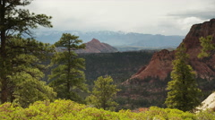 Wide panning shot of canyon and mountain range / Zion National Park, Utah, Stock Footage