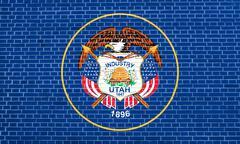 Flag of Utah on brick wall texture background Stock Illustration