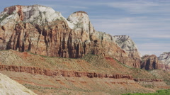 Wide panning shot of scenic view of clouds over canyon / Zion National Park, Stock Footage