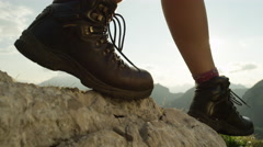 CLOSE UP: Detail of female hiking boots and hiking downhill on rough terrain Stock Footage