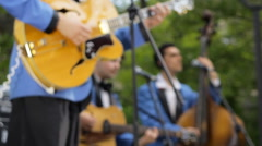 Jazz band playing musical instruments on stage. Anonymous blurred people in blue Stock Footage