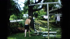 1965: the responsible homeowner takes care of his lawn at the noon hour HAWAII Stock Footage