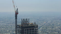 Timelapse of Construction Crane at New High-Rise in Downtown LA -Pan Left- Stock Footage