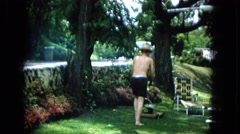 1965: mowing the lawn in straw hat HAWAII Stock Footage