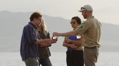Medium shot of park rangers discussing water samples with visitors / Vineyard, Stock Footage
