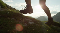 CLOSE UP: Detail of leather mountain shoes and woman climbing steep mountain Stock Footage