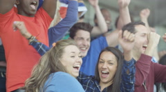 4K Excited fans with British flag in sports crowd celebrating & cheering on team Stock Footage