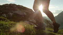 CLOSE UP: Detail of leather mountain shoes and female climbing steep mountain Stock Footage