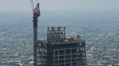Timelapse of Construction Crane at New High-Rise in Downtown LA -Zoom Out- Stock Footage