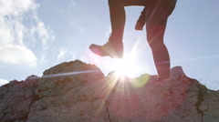 LOW ANGLE: Unrecognizable female hiker in leather boots climbing mountaintop Stock Footage