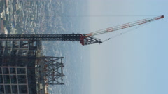 Timelapse of Construction Crane at New High-Rise in Downtown LA -Vertical/Pan- Stock Footage
