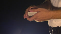 Closeup Side View Conjurer Hands Shuffle Cards into Fan Stock Footage