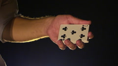 Closeup Hands Show Black Clubs Card against Darkness Stock Footage