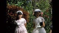 1965: three little girls dressed very formally in white clothes, gloves and hats Stock Footage
