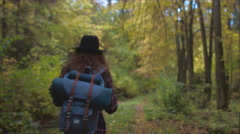 TRACKING FOLLOW Active healthy Caucasian woman hiking in autumn forest Stock Footage
